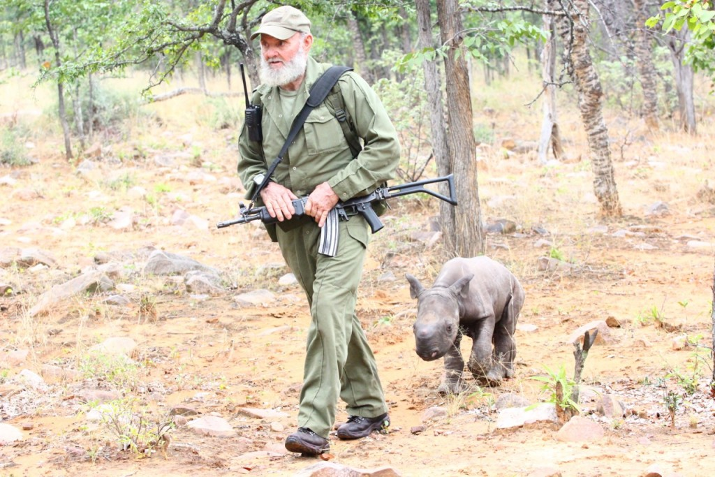 Bryce's father, Pete Clemence, with a baby rhino saved after its mother was poached last year in Save Valley Conservancy, Zimbabwe.  The calf is now being rehabilitated at a nearby conservancy for eventual return to the wild.